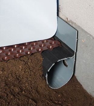 Closeup of a crawl space drainage system installed in Clemson