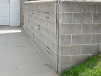 A retaining wall separating from the adjoining walls in Franklin