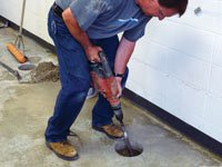 Coring the concrete of a concrete slab floor in