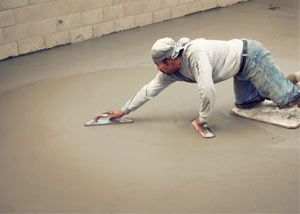 smoothing out the grout in a slab releveling project in Greer