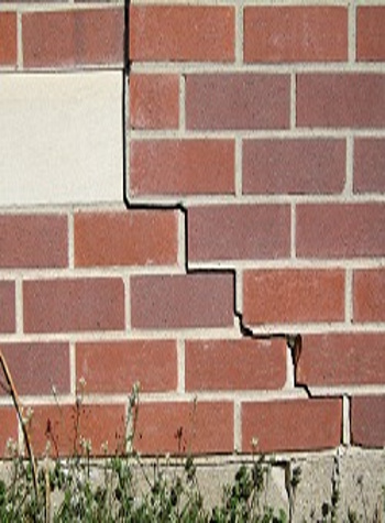 photo of a rotating foundation wall with cracks in Clemson
