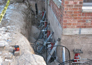 Foundation push piers installed around a house with a foundation settlement issues in Clemson