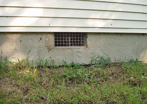 Open crawl space vents that let rodents, termites, and other pests in a home in West Columbia