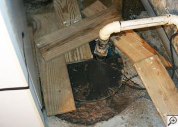An ugly, clogged sump pump system in Greer, North Carolina, South Carolina & Georgia