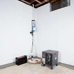 Sump pump system, dehumidifier, and basement wall panels installed during a sump pump installation in Taylors