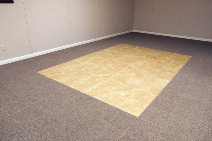 tiled and carpeted basement flooring installed in a Columbia home