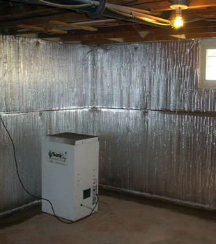 Radiant heat barrier system for unfinished basement walls